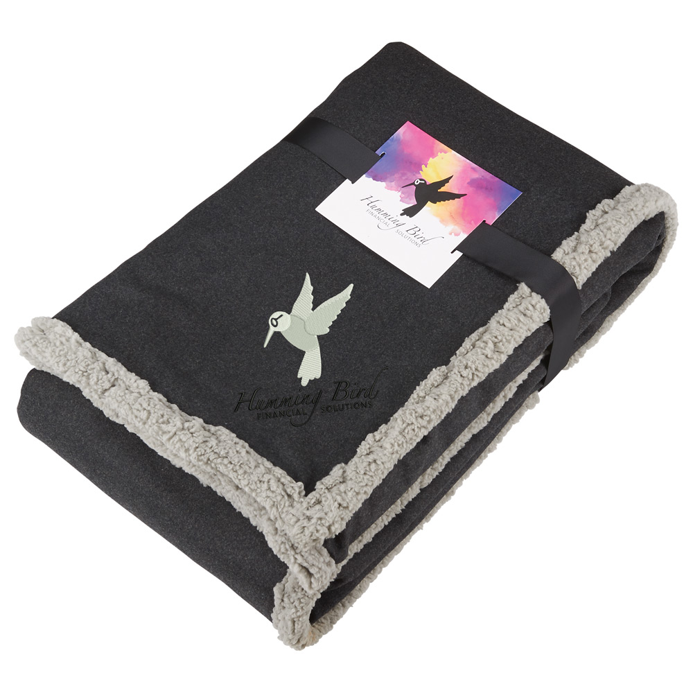 Sherpa blanket with embroidered logo and full color printed custom tag