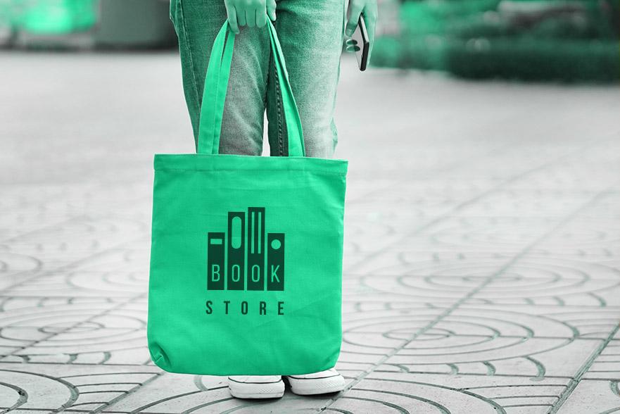 Woman holding custom screen printed fabric tote bag