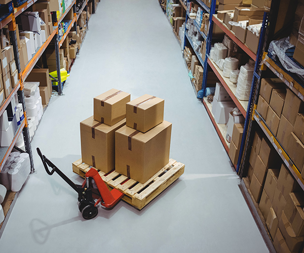 Items in warehouse with forklift moving products
